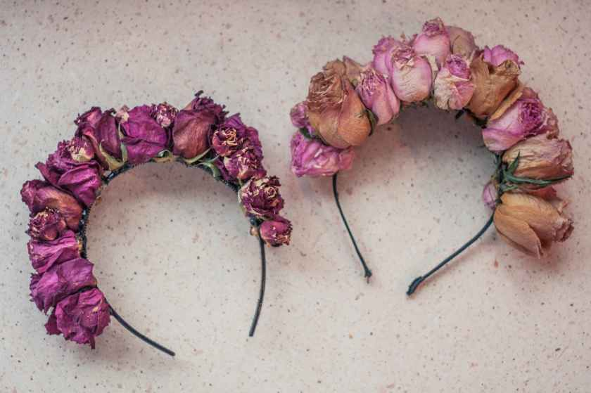 two pink rose flower accent headbands on white surface