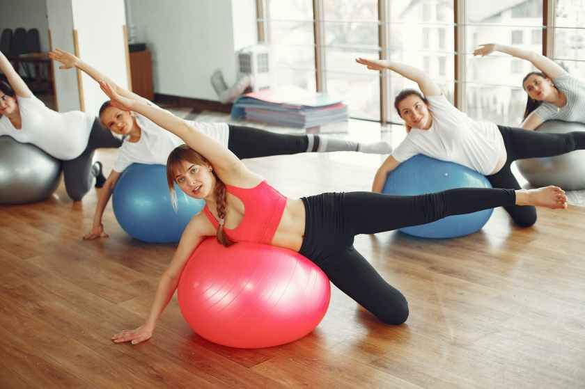positive pregnant women during exercise with fit ball in gym